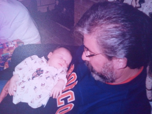 My dad, in a Broncos shirt I still have, holding Elise.