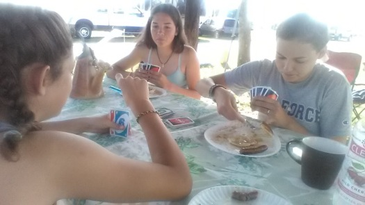 camping daughters uno cards breakfast