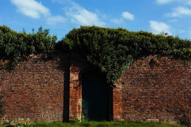 bricks wall garden door