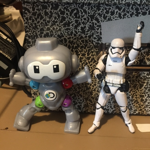 Stormtrooper dancing with a bot from a kids meal.